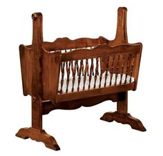 Amish Colonial Classic Baby Cradle Exquisite woodworking makes this colonial style cradle a piece of furniture destined to become a family heirloom. Handcrafted in choice of wood and stain. #cradle #woodcradle #babycradle