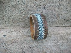 leather chainmail cuff - Instead of wire, I bet cord could be used for a cool design as well.