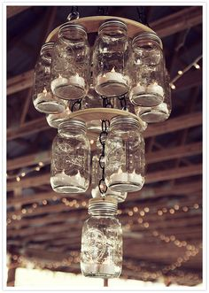 mason jar chandelier--perfect for a rustic or barn wedding---could use LED lights instead of candles