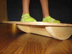 DIY balance board...ember would adore this! and weak ankles runs in the family, so this could stop that before it happens!