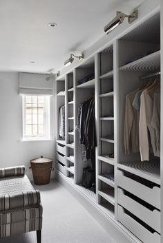 Elegant and stylish walk in wardrobe closet with smart storage solutions.