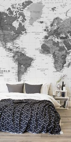 Love monochrome interiors? This stunning black and white bedroom is brought together with a larger than life map mural. Bursting with detail and character, this wallpaper mural is both breathtaking and sophisticated. || @pattonmelo