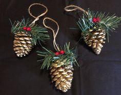These Pinecone ornaments have been painted and decorated to give a touch of gold to your rustic Christmas tree. A touch of glimmer was added to make them gleam. These beautiful pine cones will add the perfect touch to your rustic Christmas holiday! Christmas Crafts To Sell, Christmas Ornament Crafts, Holiday Crafts, Rustic Christmas, Simple Christmas, Christmas Holidays, Christmas Tree, Pine Cone Decorations, Christmas Decorations