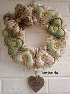 handmade wreath from El taller de Andrea . homespun look with fabric wreaths in pale green prints . wooden buttons and paper ribbon bow . Valentine Wreath, Valentine Decorations, Valentine Crafts, Christmas Decorations, Valentines, Fabric Wreath, Diy Wreath, Burlap Wreath, Christmas Wreaths