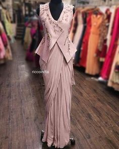 Rose pink saree gown with peplum jacket – Ricco India Indian Fashion Dresses, Dress Indian Style, Indian Designer Outfits, Fashion Outfits, Saree Wearing Styles, Saree Styles, Blouse Styles, Stylish Blouse Design, Fancy Blouse Designs
