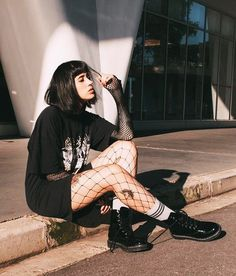Oversized shirt with shorts, fishnet leggings & Dr Martens combat boots by maybrumm