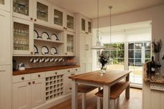 This beautiful kitchen radiates a calm feeling off of white walls and simple furnishings.