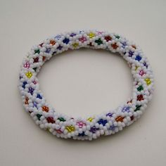 Use up all those little quantities of left over beads with this dimensional Candy Medley Bead Crochet Bangle Pattern for sale at: https://www.etsy.com/shop/WearableArtEmporium (in the Bead Crochet 12-around Section)