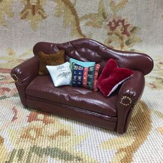 """Pat Tyler Artist Made OOAK Genuine Leather Sofa is embellished with hand tufting, buttons and hand inserted nail heads with 5 Pillows, measures approximately 6"""" Wide, 3"""" High, 2 1/2"""" Deep. The pillows"""