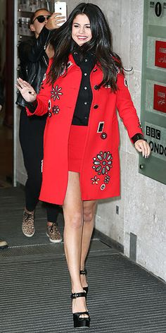 Selena Gomez in a red embellished coat and matching skirt - click through for more of her fall outfits