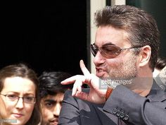 British singer George Michael gestures as he leaves the Brent Magistrates Court in London 08 June 2007 after receiving 100 hours of community service...