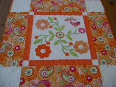 Orange, Pink and White Quilted Square Table Topper/Wall Hanging with Appliqued Flowers and Bird. $62.00, via Etsy.