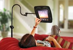 Adjustable tablet stand. Works with all tablets and folds away with a simple push.