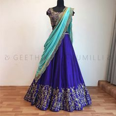 Stunning royal blue color lehenga and blouese with hand embroidery work and powder blue duppata from Geethika Kanumilli. 04 July 2017