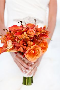 Orange bouquet - Henderson Beach State Park - vow renewal beach wedding ceremony- photo by Avant Images - Vera Wang gown - flowers by Celestines - Planning by Serendipity Designs  - www.serendipity-designs.com