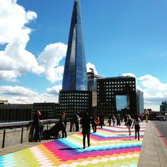 Monday Commuters Delighted by London Bridge's Transformation into Rainbow Brick Road - My Modern Met