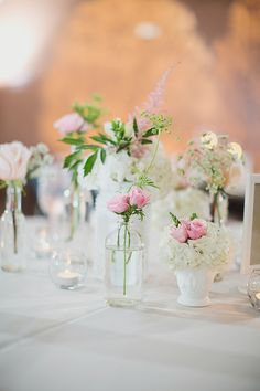 mixed vases for centerpieces // photo by Our Labor of Love by Heidi, styling by @Jackie Gregory Charming Socials http://ruffledblog.com/atlanta-arts-center-wedding #centerpieces #flowers #vases #glassbottles