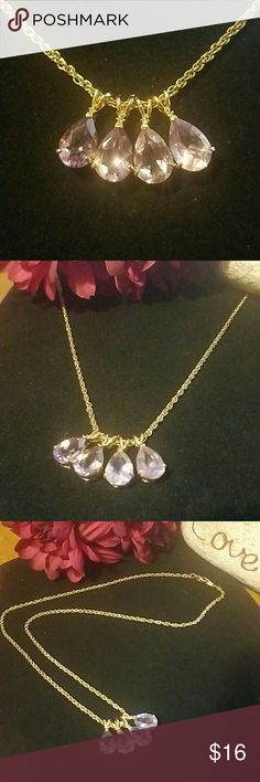 """PINK CRYSTAL TEARDROP NECKLACE This beautiful necklace has 4 teardrop shaped pink crystals in goldtone settings and dangle from a 18+"""" goldtone cable chain with lobster clasp closure. Comes in a clear box on velvet lining. Item#N122 Jewelry Necklaces"""