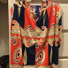 Stunning patterned blouse with tie back This beautiful blouse is flowy yet hangs for a flattering fit. Wide sleeve holes, longer in length, and tie at back of neck. Sugarlips Tops Blouses