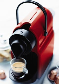 Nespresso Inissia Ruby Red | Compact in design, lightweight and equipped with an ergonomic handle, the new Inissia coffee machine fits perfectly into any interior design.
