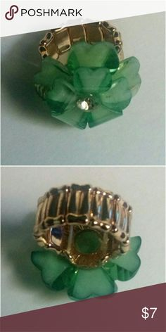 Stretchy Ring NWOT. Beautiful green flower stretchy ring. Never been used.  *Fashion Jewelry -Bundle to save on shipping cost Jewelry Rings