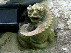 wales gargoyles | This reptilian gargoyle is on the east wall of Saint Cadwaladr's ...