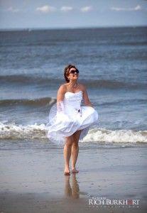 bride dances in the ocean.  Tybee Island wedding photography.  Savannah, GA wedding.  Photos by Rich Burkhart.  www.photosbyrb.com