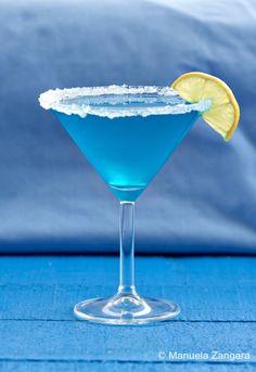 Glacier Fusion Daiquiri •35 ml – 1 ¼ oz. apple juice •20 ml – ⅔ oz. lemon juice •45 ml – 1 ½ oz. white rum •15 ml – ½ oz. Blue Curaçao •30 ml – 1 oz. simple syrup (made by mixing equal quantities of sugar and water)