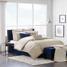 The Whittier bed is exquisite yet minimal with 100% cotton that has been enzyme washed to create a frayed edge trim for a relaxed and unique look. This bed is paired with decorative pillows of navy and mocha for extra interest. The collection includes a comforter with a removable insert, two coordinating standard shams, three euro shams, a bed skirt and three embellished decorative pillows.The bed skirt requires assembly that allows you to adjust the height to your bed frame.