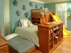 Kind of interesting setup - looks like the top bunk might be toddler sized... I like the slide, but it's big and steep for a toddler :)  But, the trundle is a good way to hide an extra bed and the room has lots of nice storage around the beds...