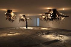 Italian artist Giuseppe Licari is the author of the installation Humus : big chandeliers, hung on the ceiling and taking the shape of roots from a real tree trunk. These pieces were exhibited on th…