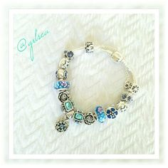 Blue charm bracelet Handmade charm bracelet with  .925 core glass beads, and tibetan charms on ss plated barrel clasp snake chain. Custom orders welcome. New, handcrafted, never worn.Custom orders welcome. New, handcrafted, never worn.Discounts given on bundles and to returning customs. Salty Grace  Jewelry Bracelets