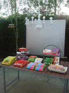 cute ideas for outdoor movie night... You can get these box candies at the 99cent store