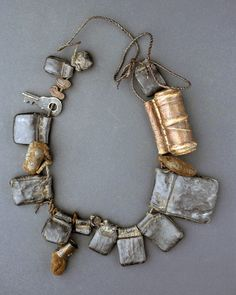 Ethiopia   Amulet necklace; leather brass and textile. Each of the leather pouches contains a small paper with prayers   Amhara, ca. 1971
