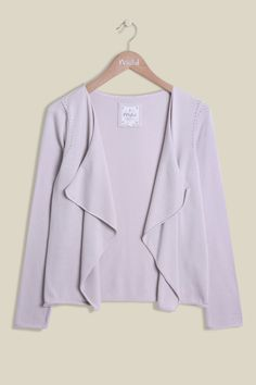 Inspired by the fields of Wiltshire Water Meadow, our Tea Cardi is a must this season. The elegant edge-to-edge knit is made from lightweight cotton, perfect for layering. Designed in a beautiful soft blush pink, the clean cardi features long sleeves with delicate detailing around the shoulders. Also available in Cactus.