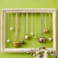 Using decorative ribbon, string jingle bells of different sizes and colors from the top of a rustic looking frame. The subtlety of this holiday look means you can display the piece year-round if you'd like.