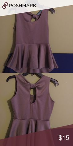 Blouse Medium, sleeveless blouse. Great for business or leisure. Goes well with jeans or pants. Tops Blouses