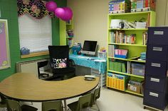 I like this idea of having a smaller teacher area at the back of the room and have it connected with a kidney shaped table for small group time or a center. I don't believe I'll be at my desk when students are around anyways, so I don't mind it facing the wall.