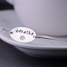 Love this simple bracelet that holds such an important reminder. :: Breathe Bangle by georgiedesigns