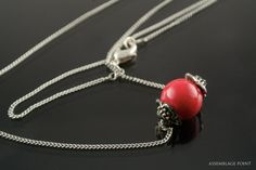 Pendant with red bead от AssemblagePt на Etsy