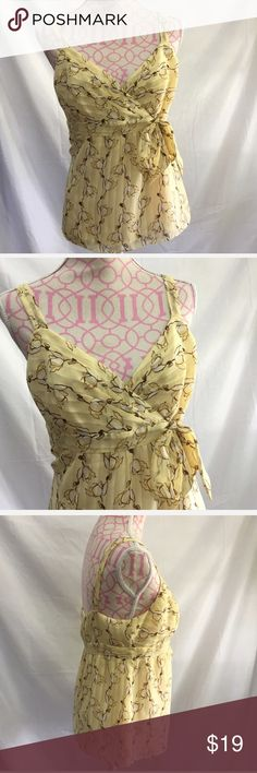 🎀3 For $30 Loft Dress Top Size 10P Loft yellow floral print top. Sleeveless. Attached belt. Lined. Side zipper.  Size 10 petite  Bust approximately 36 inches  Length approximately 25 inches  100% polyester LOFT Tops Blouses