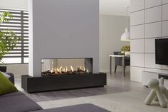 imitation of the fireplace - Transform your Spacious Space with a Double-Sided Fireplace