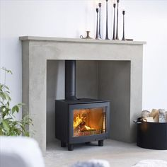 Part of a range of freestanding and inset stoves with a large landscape window showing a large flame picture. - Part of a range of freestanding and inset stoves with a large landscape window showing a large flame picture. Inset Log Burners, Modern Log Burners, Inset Stoves, Modern Stoves, Wood Stoves, Wood Burner Fireplace, Wood Burning Fireplace Inserts, Fireplace Ideas, Fireplace Mantles