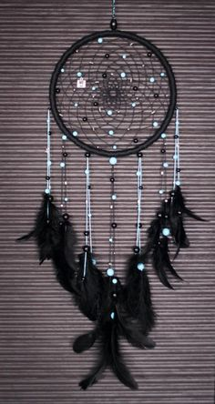 Dark Dreamcatcher with blue/black beads and ropes by MyFreeDreams