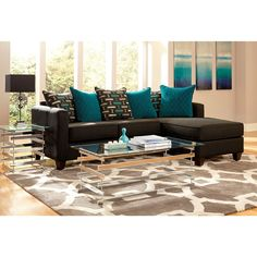 Upholstered in a charcoal black chenille fabric this 2-piece sectional features abstract print scatter back pillows, and generous comfortable seating area. Ottoman and chaise pillow can be placed on either side to make a left or right chaise.