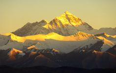 Golden Himalayas. The highest peak is the world's most elevated mountain, the Everest.