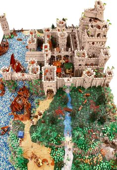 A labyrinth of gray towers and walls, hidden chambers, a busy port and marketplace. A proper medieval castle needs all of these, and LEGO fanatic Marco den Besten made sure his giant fantasy build had all that and a lot more. Lego Design, Lego City, Legos, Chateau Lego, Lego Burg, Chat Origami, Casa Lego, Lego Sculptures, Amazing Lego Creations