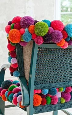 Pom-Pom Chair  For a fun look and comfort use the pom-poms to decorate the old chair!