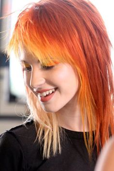 Hayley Williams of Paramore. Love her orange on yellow Hair. And those layers!