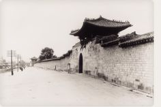 Gyeongbokgung, the Main Palace of the Joseon Dynasty Geonchunmun Gate in the 1920s  During the Japanese colonial period(1910-1945), the front wall was taken down and the rest was damaged during the Korean War(1950-1953). The current palace walls have been rebuilt several times since, redrawn further inside the original walls.